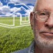 Melancholy Senior Man with Grass Field and Ghosted House Behind — Stock Photo #38920241