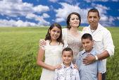 Hispanic Family Portrait Standing in Grass Field — Stock Photo