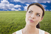 Contemplative Woman in Grass Field Looking Up and Over — Stock Photo