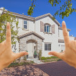 Stock Photo: Female Hands Framing Beautiful House