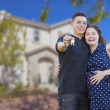 Hispanic Couple with House Keys In Front of New Home — Stockfoto
