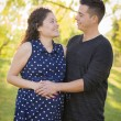 Hispanic Man With His Pregnant Wife Outdoors At the Park — Stock Photo