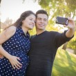 Pregnant Wife and Husband Taking Cell Phone Picture of Themselve — Stock Photo