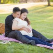 Pregnant Hispanic Couple in The Park Outdoors — Stock Photo