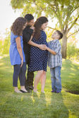 Happy Attractive Hispanic Family With Their Pregnant Mother Outd — Stock Photo