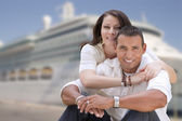 Young Happy Hispanic Couple In Front of Cruise Ship — Stock Photo
