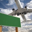 Blank Green Road Sign and Airplane Above — Stock Photo
