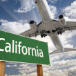 California Green Road Sign and Airplane Above — Stock Photo