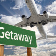 Getaway Green Road Sign and Airplane Above — Stock Photo #41885617