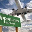 Opportunity Green Road Sign and Airplane Above — Stock Photo