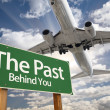 The Past Green Road Sign and Airplane Above — Stock Photo