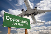 Opportunity Green Road Sign and Airplane Above — Foto Stock