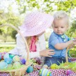 Cute Young Brother and Sister Enjoying Their Easter Eggs Outside — Stock Photo #43076237
