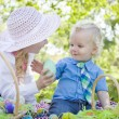 Cute Young Brother and Sister Enjoying Their Easter Eggs Outside — Stock Photo #43076295