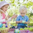 Cute Young Brother and Sister Enjoying Their Easter Eggs Outside — Stock Photo