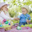Cute Young Brother and Sister Enjoying Their Easter Eggs Outside — Stock Photo #43076335