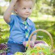 Cute Little Boy Outside Holding Easter Eggs Tips His Hat — Stock Photo #43076429