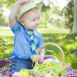 Cute Little Boy Outside Holding Easter Eggs Tips His Hat — Stock Photo