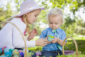Cute Young Brother and Sister Enjoying Their Easter Eggs Outside — Stockfoto