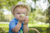 Cute Little Boy Enjoying His Easter Eggs Outside in Park — Stock Photo