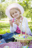 Cute Young Girl Wearing Hat Enjoys Her Easter Eggs — Stock Photo