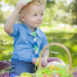 Cute Little Boy Outside Holding Easter Eggs Tips His Hat — Stock Photo #43270503