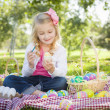 Cute Young Girl Coloring Her Easter Eggs with Paint Brush — Stock Photo