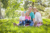 Young Attractive Family Portrait in the Park — Stock fotografie