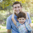 Handsome Mixed Race Father and Son Park Portrait — Stock Photo #46005399