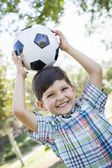 Cute Young Boy Playing with Soccer Ball in Park — Stock Photo