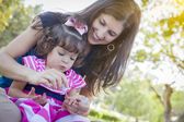 Young Mother and Cute Baby Girl Applying Fingernail Polish — Stock Photo