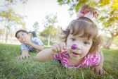 Cute Baby Girl and Brother with Lollipops in Park — Stock Photo