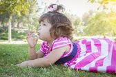 Cute Baby Girl Enjoying Lollipop Outdoors — Stock Photo