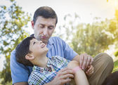 Loving Father Puts Bandage on Knee of Young Son — Stock Photo
