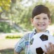 Cute Young Boy Playing with Soccer Ball in Park — Stock Photo #46373743