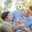 Loving Father Tickling Son in the Park — Stock Photo #46373765