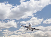 Jet Airplane Landing with Dramatic Clouds Behind — Stock Photo