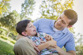 Loving Father Tickling Son in the Park — Stock Photo