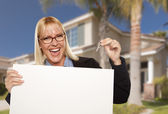 Excited Woman Holding House Keys and Blank Real Estate Sign — Stock Photo
