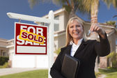 Female Real Estate Agent Handing Over the House Keys — Stock Photo