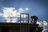 Construction Worker Silhouette on Roof — Foto Stock