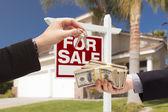 Agent Handing Over Keys, Buyer Handing Over Cash for House — Stock Photo