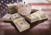 Thousands of Dollars, Piggy Bank, American Flag Reflection on Ta — Stock Photo