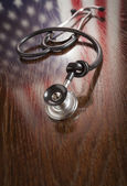 Knotted Stethoscope with American Flag Reflection on Table — Stock Photo