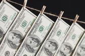 Hundred Dollar Bills Hanging From Clothesline on Dark Background — Stock Photo