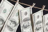 Hundred Dollar Bills Hanging From Clothesline on Dark Background — Stock Photo