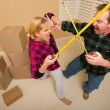 Couple Having Fun Sword Fight with Tape Measures — Stock Photo #4783076