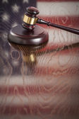 Wooden Gavel Resting on Flag Reflecting Table — Stock Photo