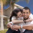Happy Hispanic Young Couple in Front of Their New Home — Stock Photo