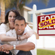 Hispanic Couple, New Home and Sold Real Estate Sign — Stock Photo #48391657